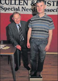 Dr Patrick Casey monitors the 51 pound loss by Anthony Barry from Millstreet at the closing of the Cullen Weigh In 2012. Picture John Tarrant