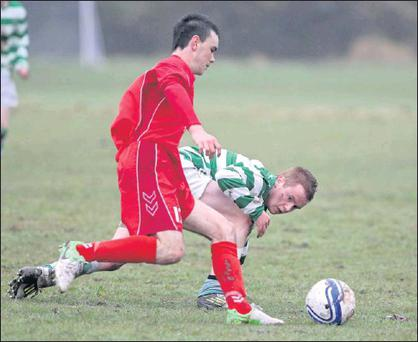 Kevin Crowley, Killumney, battles with Shane Creedon, Macroom, during the Daly Industrial Supplies Under 18 League 1 game, in Killeady last weekend Credit: Photo: Jim Coughlan