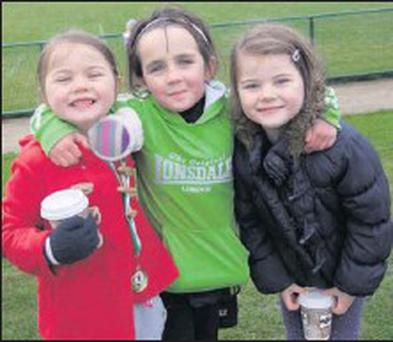 Katie Doheny and her cousins Vanessa and Amy Brennan, under-9 medal winners.