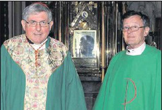 Cardinal Thomas Collins from Toronto with Monsignor Jim Carroll at the shrine of St. Oliver during his 'moving' visit to Drogheda earlier this year.