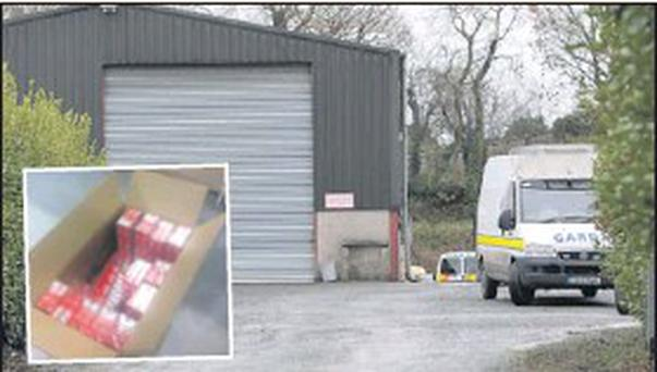 Gardaí at the scene near the graveyard in Mullary on Thursday morning; (inset) some of the cigarettes seized by gardaí.