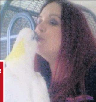Juliana Milne Donnelly with her cockatoo Tyson, which she was forced to leave behind in Drogheda when she moved to Australia.