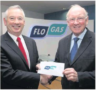 Tom Wall of Flogas Ireland presents a €500 cheque to Michael Grogan, Drogheda area vice-president of St. Vincent de Paul.