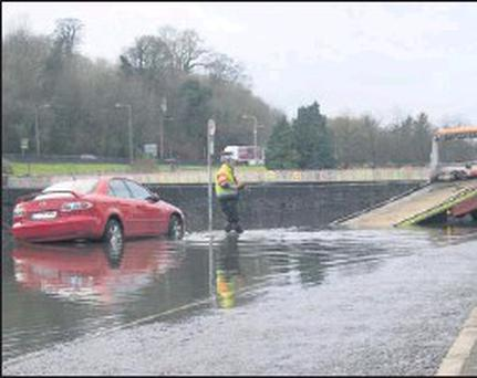 One motorist has their car towed away as a result of the heavy flooding.