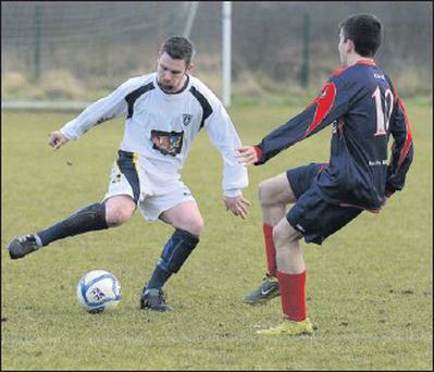 Ardee's James Woods finds his route blocked by Keith Scanlon (Kells-Blackwater). Pics: Colin Bell