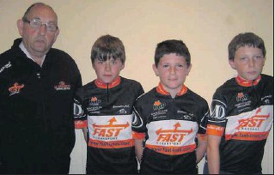 Gay Howard with club riders (l to r) Sean O'Connell, Emmet Gorman and Luke Coll, showing off Stamullen M Donnelly Road Club's new kit.