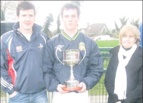 Adrian and Sally Reid with winning Meath captain, James McEntee.