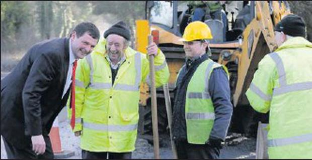 Shane chatting with Meath County Council employees while viewing progress on works on the R162, the Kingscourt to Nobber road.