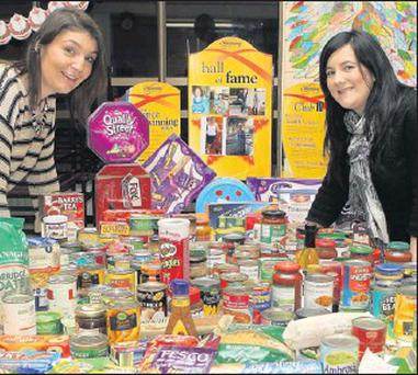 Diane Kelly of Slimming World, St. Joseph's with Ciara Branigan of Drogheda Homeless Aid with the food donations from Slimming World members.
