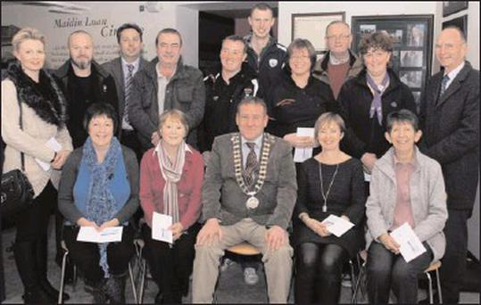 Representatives of 13 of the 14 groups who received this year's funding from Enniscorthy Town Counicl, with Council chairman Keith Doyle and Town Clerk Pádraig O'Gorman at the presentation ceremony in the '98 Centre last Monday night. Back, from left:...
