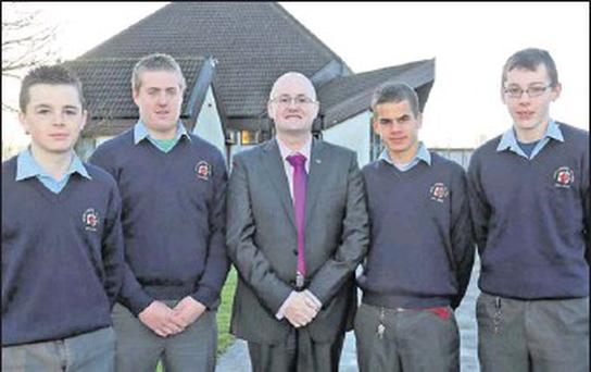 Good Counsel College (New Ross) students who won the Leinster schools Junior golf recently and have qualified for the All-Ireland final to be held in Balmoral in April (from left): Ronan Whelan, Michael Ryan, Fr. John Hennebry (principal), Paul Murphy...