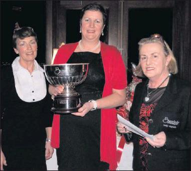 Bunclody lady golfer of the year, Margaret Moore, accepting her trophy from lady Captain Liz Byrne and lady Vice-Captain Alice Druhan.