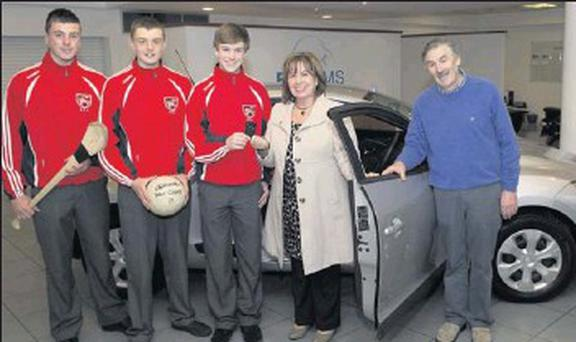 Fingallians U15 squad members Liam Scully, Tadhg Collins, Derek Rodgers, with Maureen Quille and her husband John who won the Renault Megane in the Crumlin Children's Hospital Car Draw