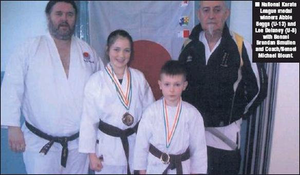 National Karate League medal winners Abbie Beggs (U-13) and Lee Delaney (U-8) with Sensei Brendan Smullen and Coach/Sensei Michael Blount.