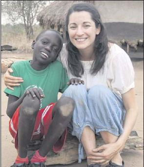 ■ Meabh Smith from Swords, who works for Trocaire, with Daniel Okweng (9), the boy on this year's Trocaire box, in Bar Kawach, Barlonyo, north Uganda. (Photo: Jeannie O'Brien)