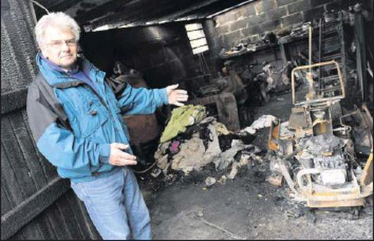 Club treasurer Joe Smith points out the damage caused at Glebe North soccer club.