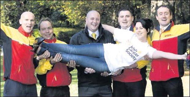 DHL staff pictured earlier in the year at the launch of their fundraising initiative.