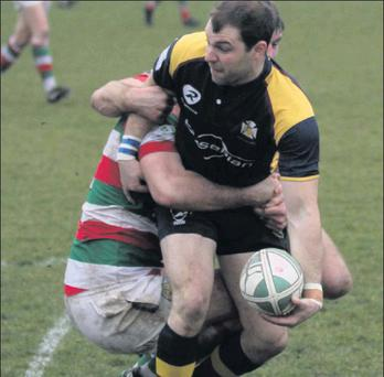 Winger Paul Devitt attempts to off-load in the tackle during Skerries' Leinster Division 2A/2B Cup clash with Bective Rangers at Holmpatrick last Saturday.