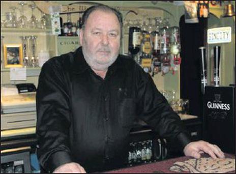 Des Whelan behind the bar at the Wicked Swan.