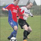 Nicky Kehoe (Curracloe United) and Shane Goff (Kilmore United) in a tussle during their Division 1 game on Sunday last.