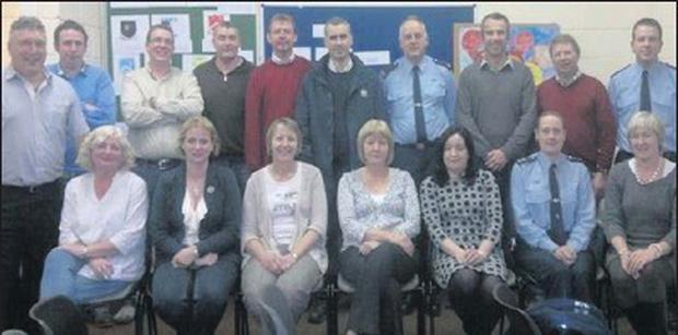Clologue-Ballymore Community Alert Group committee members with representatives of the Garda Síochána at the recent launch night in Clologue National School.