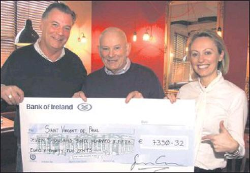 Celebrity chefs Derry Clarke and Clodagh McKenna had over a cheque for €7,350.32 to Jim Lee, Gorey president of St. Vincent de Paul.