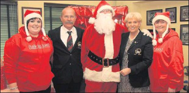 Santa paid a flying visit to Courtown Golf Club ahead of his worldwide dash on Christmas Eve. Here he is pictured with, Shauna Coone, captains, Karl Caulfield and Barbara Long with Maria Coone.