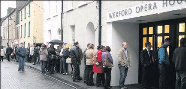 A queue forms outside Wexford Opera House as Eishtec hosts information days for prospective candidates.