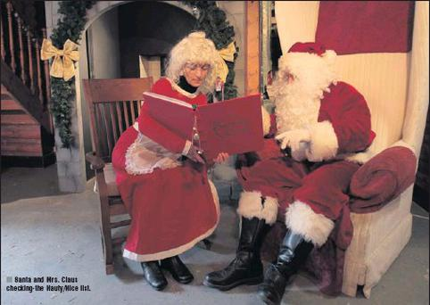 Santa and Mrs. Claus checking the Nauty/Nice list.