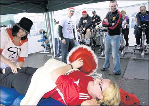 Mary Toomey getting the full treatment from Kay McDonnell after her marathon Spinathon in The Square in Listowel on Friday afternoon. Credit: Photo by John Reidy
