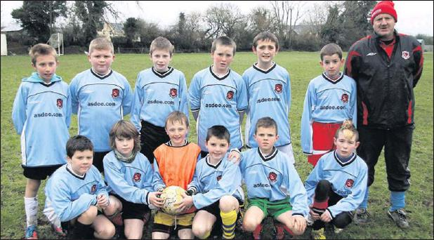 The Asdee Rovers U-11 schoolboy soccer team pictured with their coach, Eric O'Neill, before their league game against Castleisland on Saturday. Photo by John Reidy