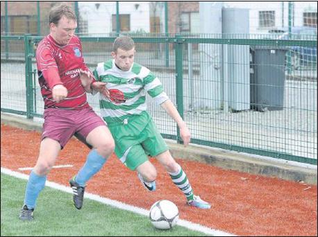 Killarney Celtic's Gary Keane, on right, tries to hold off Matt Sullivan, Broadford United, during their FAI Junior Cup played at Celtic Park in Killarney last Sunday