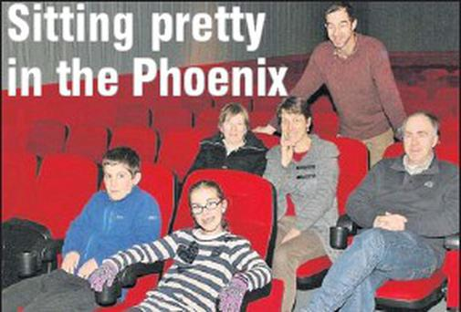 The O'Sullivan family take a seat in the refurbished Phoenix Cinema. From left: Maxime, Mirian, Kathleen, Natalie, Francis and (standing) Seán O'Sullivan. Credit: Photo by Marian O'flaherty