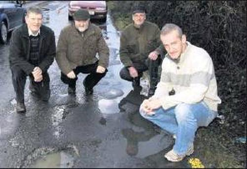 Cllr. Mikey Kennelly (right) with local residents: Jerry Brick, John Lonergan and Christy Murphy on the stretch of road at Clieveragh which is being washed away by water running off the land. Credit: Photo by John Reidy