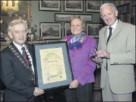Dr Isolde Liebherr, Vice-President, Liebherr International, receives the Order of Innisfallen Civic Award from Killarney Mayor Seán O'Grady, left, and Michael Buckley, President, Killarney Chamber of Tourism & Commerce at a special function in Muckross... Credit: Photo by Don Macmonagle