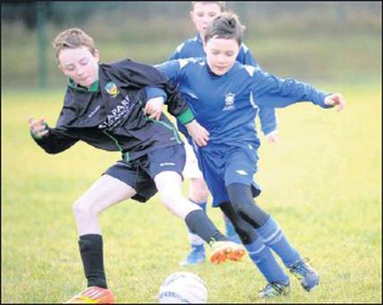 Jamey Muldoon, Killarney Athletic, on right, and Darragh Broderick, Kingdom Boys, battle for possession in his tracks in the Kerry Schoolboys U12 Premier game in Woodlawn, Killarney on Saturday. Credit: Photos by Michelle Cooper Galvin