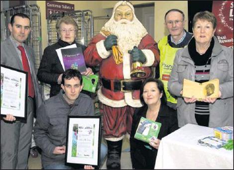 RIGHT: Garvey's SuperValu, Listowel branch manager, Paul O'Connor (left) pictured with members of the Listowel Tidy Towns committe during their awareness promotion day at the store on Saturday. Included are, front: Jimmy Moloney and Eleanor Enright.... Credit: Photo by John Reidy
