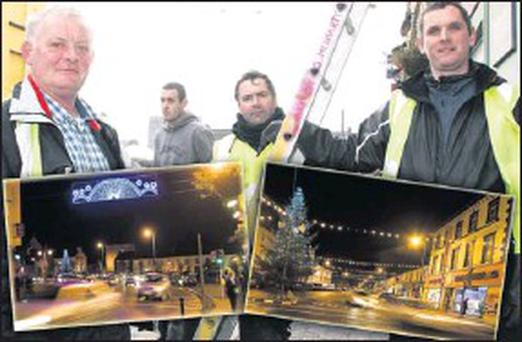 Putting the finishing touches to the Christmas lights in Listowel on Thursday morning were from left: Sean Moriarty, John Costelloe and Conor Moriarty. Insets: The Moriarty magic of the Christmas lighting on The Square (left) and on Market Street. Credit: Reidy Photos by John
