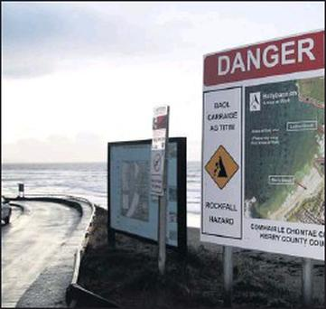 The bi-lingual danger signs in Ballybunion which locals say are creating the wrong impression of the North Kerry resort. Credit: Photo by John Reidy