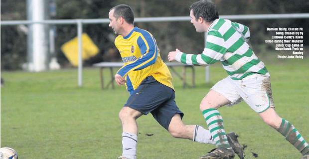 Damien Reidy, Classic FC being chased by by Listowel Celtic's Kevin Dillon during their Munster Junior Cup game at Mounthawk Park on Sunday Credit: Photo: John Reidy
