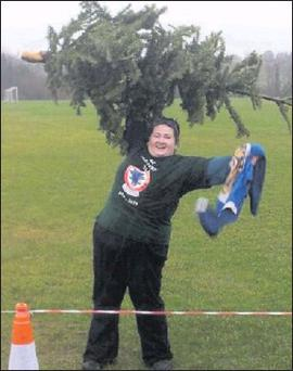 Julia Galvin who came second in a Chrtstmas tree throwing competition in Ennis at the weekend.