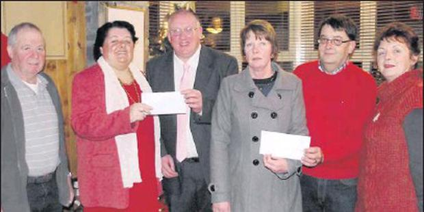 Jackpot winners Anne and Donie McGrath, Glin, receiving their cheque for €8,300 from Lillian Fitzgerald, Athea Lucky Numbers committee, also Tom O'Grady who sold the winning ticket with Joan and Dan Griffin, Lucky Numbers committee