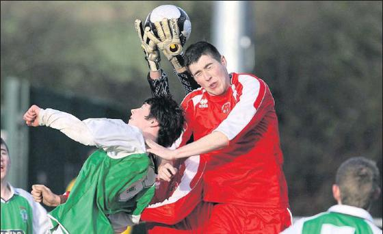 A vital touch by Kerry keeper, Colin Griffin averts the danger posed by Cork's Corey Long and Ryan Meaney with Kerry's Ryan Carroll also defending during their FAI Youths Inter League game at Mounthawk Park on Saturday afternoon. Photo: John Reidy