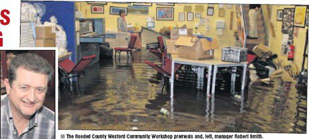 The flooded County Wexford Community Workshop premesis and, left, manager Robert Smith.