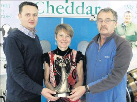 Ann Sullivan of D.M.P. received her Wexford Creamery athlete of the month award for August from Neil Murphy of Wexford Creamery (sponsors) and Paddy Morgan (Wexford Athletics Chairman).