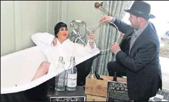 Niamh White as 'Gilda Grey' and Tom White as 'Bugsy Malone' preparing for the 'Bootleggers Ball' in Horetown House on New Year's Eve.