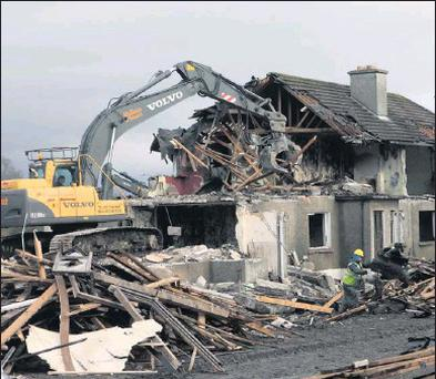 ■ Demolishing of Doorly Park maisonettes yesterday, (Monday).