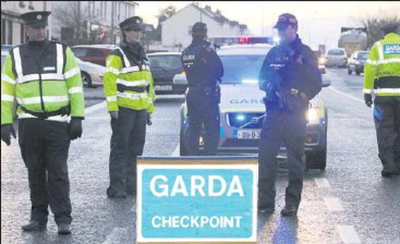 Gardai carry out an armed checkpoint in Dromore West last weekend.