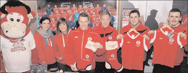 Pictured at the newly opened Sligo Rovers store in The Quayside Shopping Centre: Benny the Bull, Sinead Martyn, Rebecca Gorman, Danny North, Ryan Connolly, Seamus Conneely and Jeff Henderson.