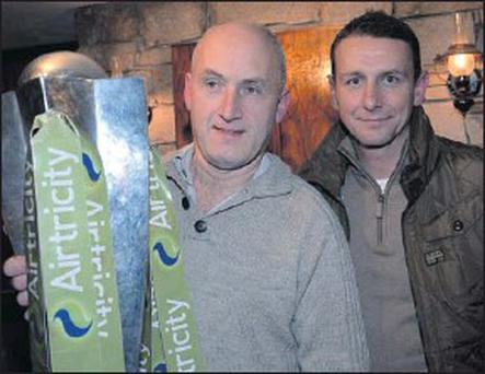 Pat McKeon and Sligo Rovers manager Ian Baraclough pictured with the Airtricity League trophy in Moran's pub in Ballintogher.